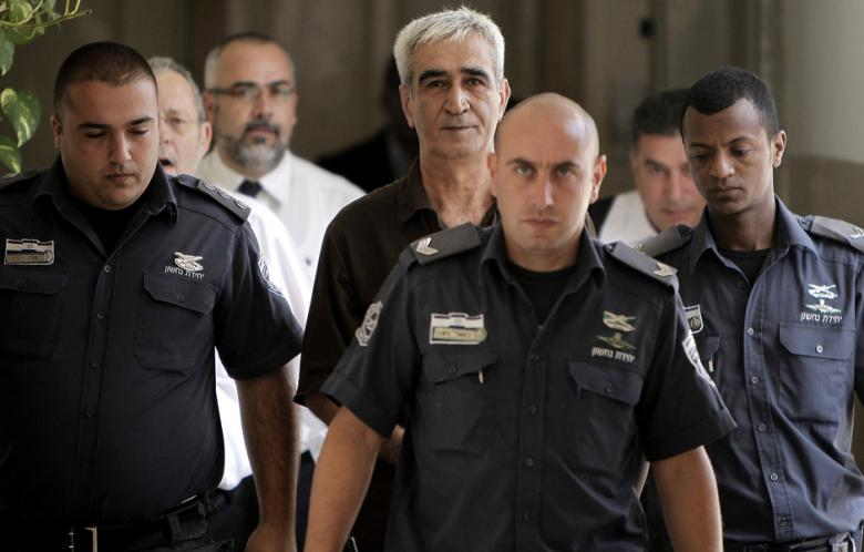 Ahmed Saadat (C), leader of the Popular Front for the Liberation of Palestine (PFLP), is escorted by Israeli police as he arrives to attend a hearing in his trial at the Magistrate's Court in Jerusalem on 9 September 2012. (Photo: AFP - Ahmad Gharabli)